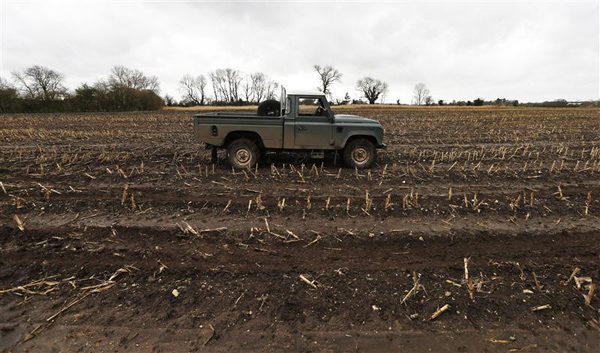 A truck is parked in a field during a pheasant shoot in Lewknor, southern England