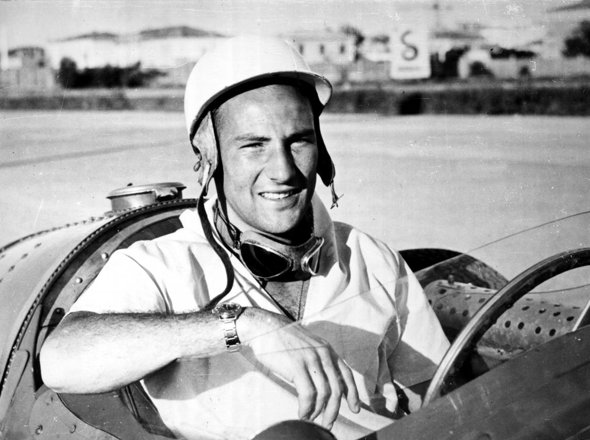 Sir Stirling Moss in a Maserati 250F.photo Maserati NA